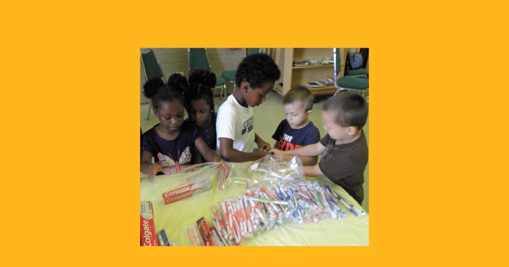 Children filling Walls of Love bags, Elyria, Ohio, 7/29/19