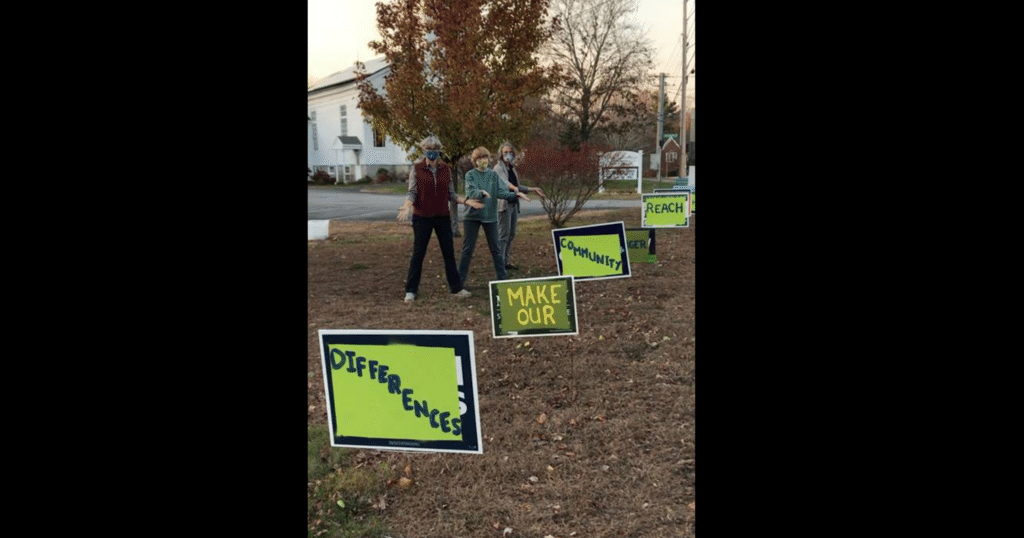 UCC members in Cumberland, Maine, with repurposed political signs in 2020