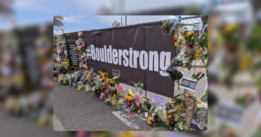 Fence with #Boulderstrong banner, March 2021