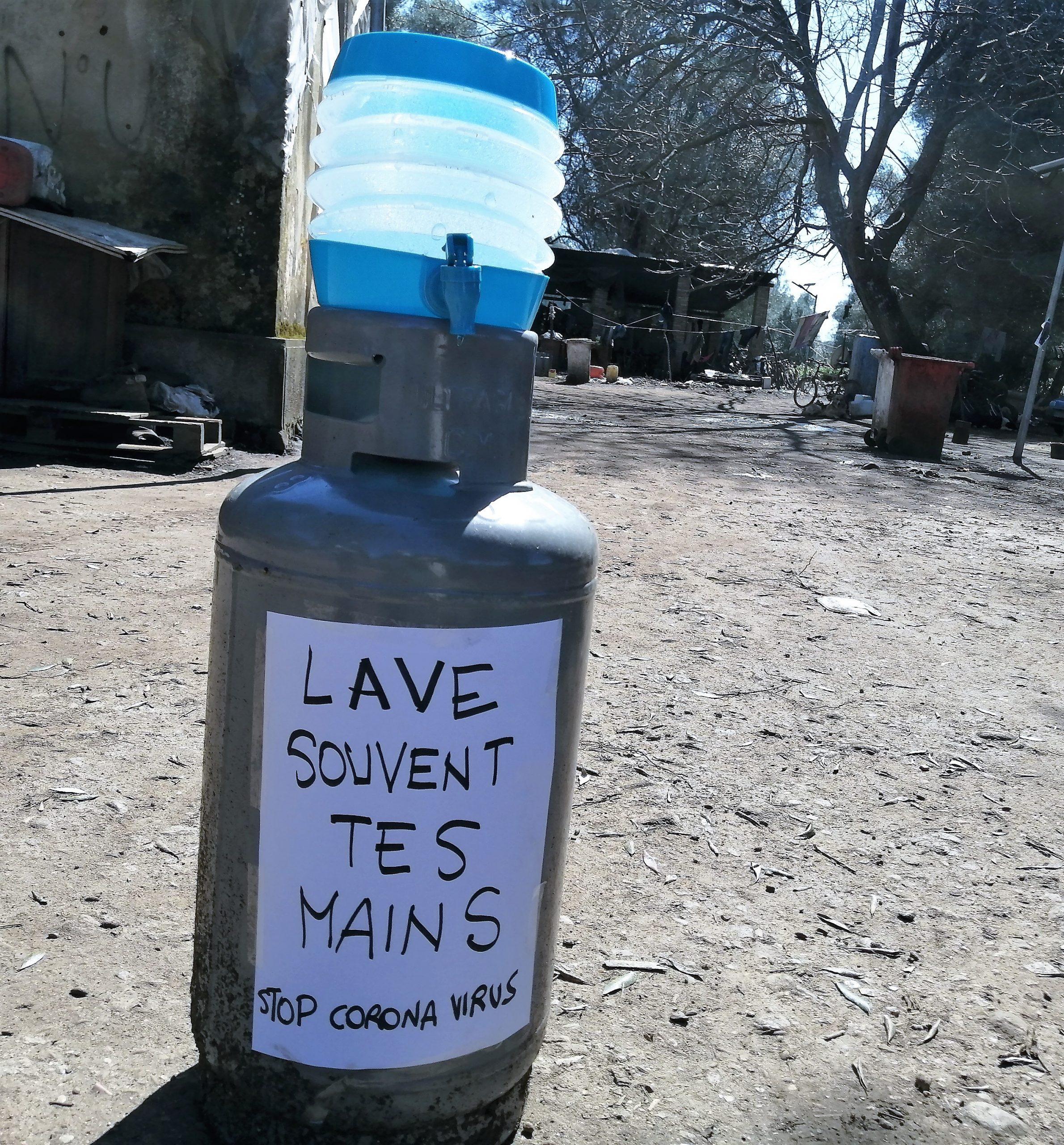 Hand-washing station, refugee camp, Italy