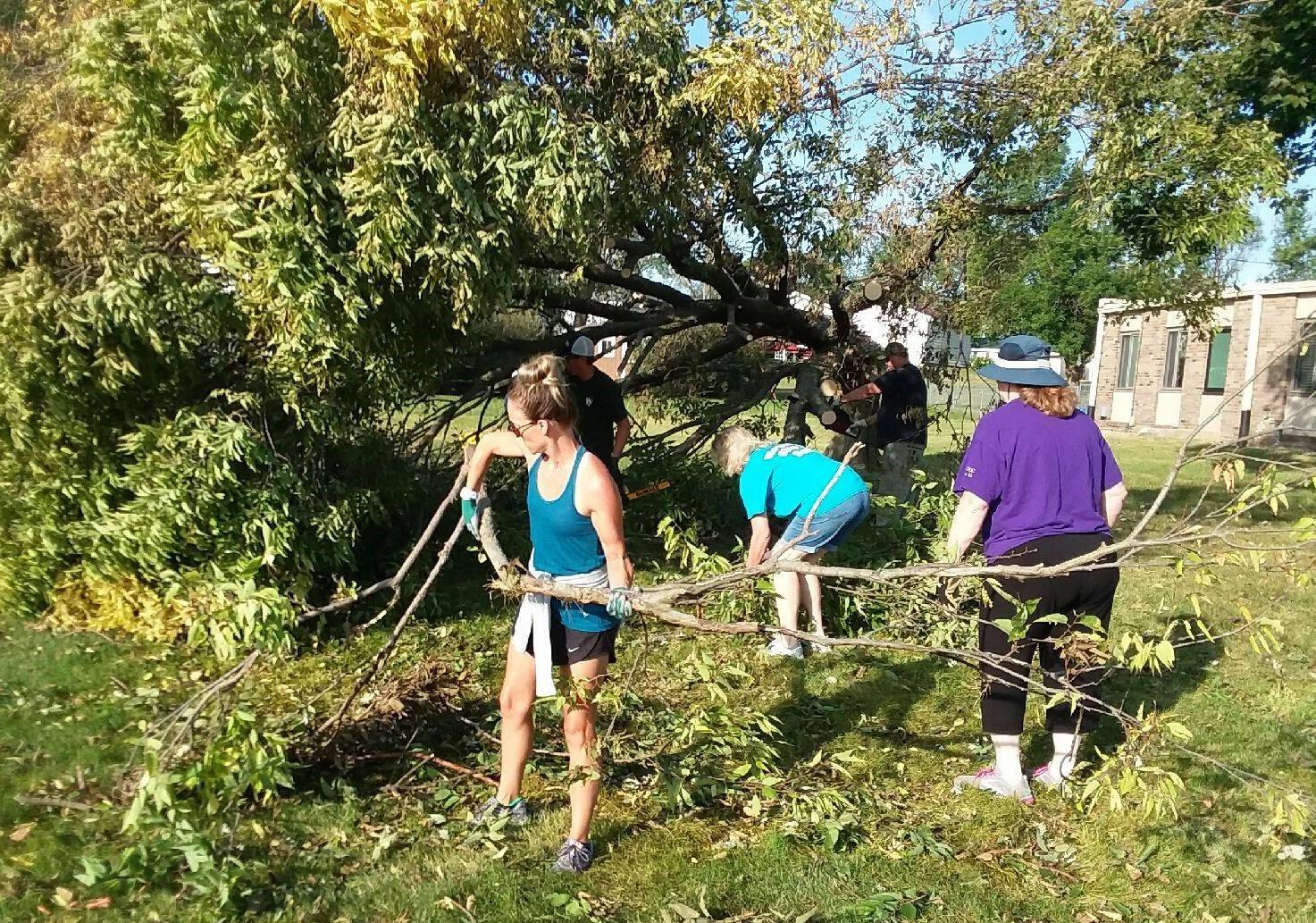 Hope UCC members clear fallen tree, Aug. 2020
