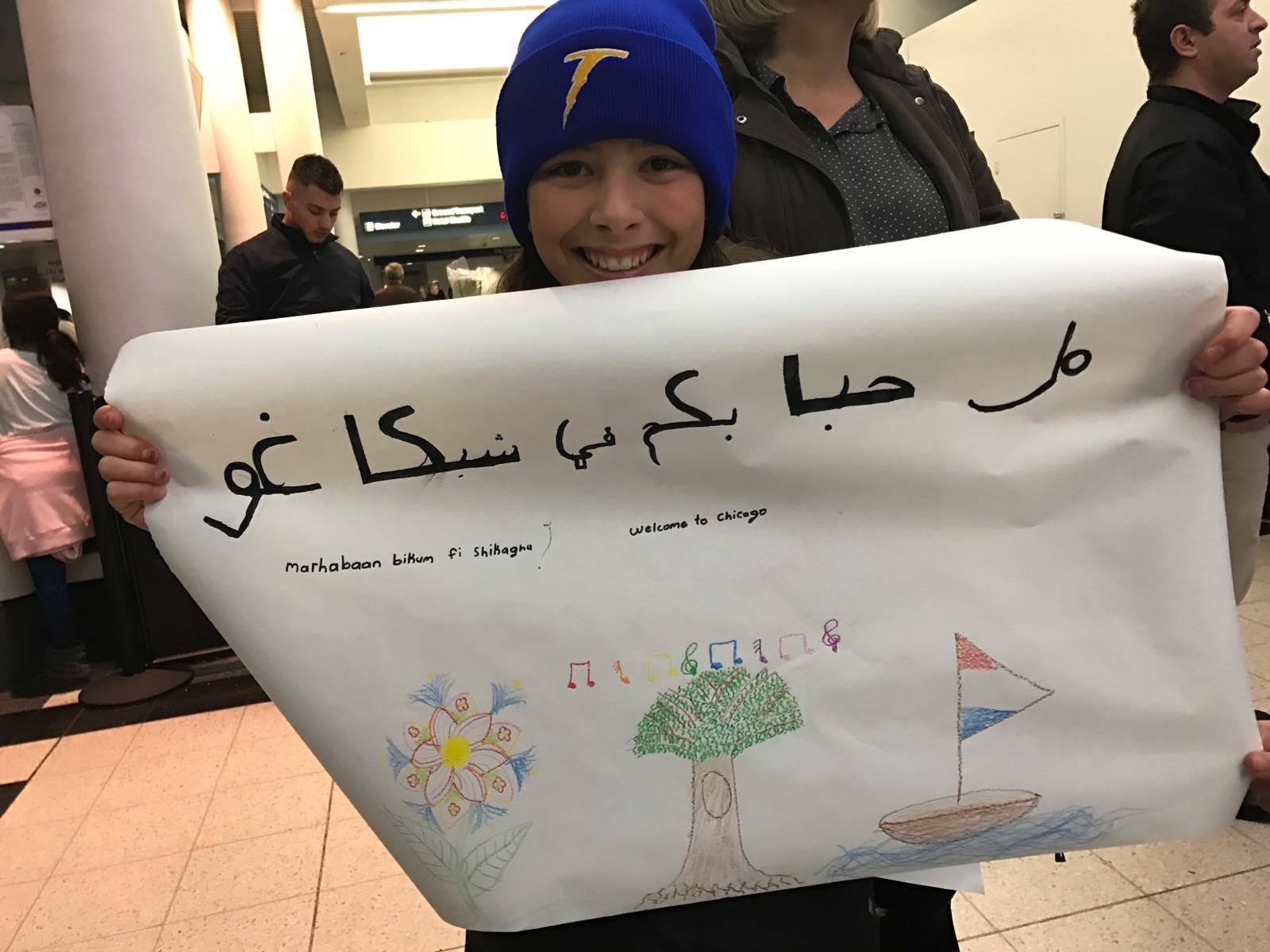 refugee_family_feb_2017_6_natalie_greeting_family.jpeg