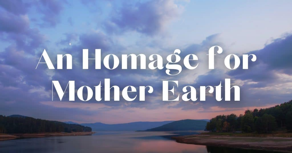 """Looking out over a lake to the mountains with a sunset. Includes the words, """"An Homage for Mother Earth"""""""